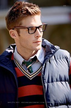 Ivy League Puffer Vest, Red & Navy Striped Sweater, Oxford Cloth Shirt, Rep Tie, and Schoolboy Glasses. Men's Fall/Winter Street Style Fashion.