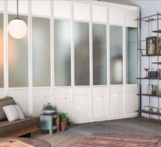 The Frankford Panel System in white with brass hardware.