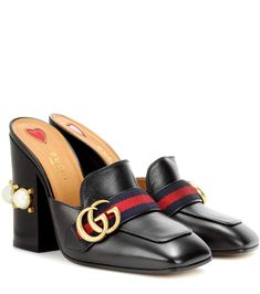 GUCCI - Leather loafer mules - Gucci's signature loafer silhouette has been transformed into a chic pair of mules this season for contemporary appeal. The faux pearl-embellished heel, GG charm and striped ribbon add undeniable recognition to the black leather design. Temper the chunky heel by styling yours with chiffon dresses. - @ www.mytheresa,com
