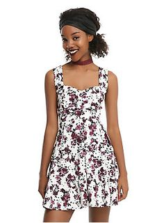 """<div>A floral dress can be dark and mysterious without being black, and this dress is proof. The white dress features an allover burgundy flower and skull print. The fitted bodice has a flattering gathered sweetheart neckline with wide tank straps. A fitted waistline can be emphasized even more by the back lace-up corset detail. The full circle skirt will have you spinning with happiness! Side zipper closure.</div><div><ul><li style=""""list-style-position: inside !important; list-style-t..."""