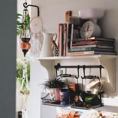 cute kitchen shelf, I like the way the little ornament is hanging from the metal hanger