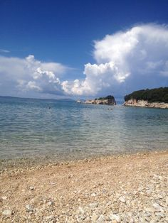 Syvota dei beach,Epirus.       The water is warm and the beach is pebbly