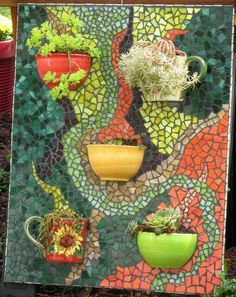 This mosaic is done on Hardibacker cement board. Cups and bowls cut in half and attached with silicone. Mosaic Planters, Mosaic Garden Art, Mosaic Vase, Mosaic Flower Pots, Mosaic Wall Art, Mosaic Diy, Mosaic Crafts, Mosaic Projects, Mosaic Tiles