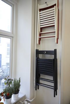Find extra storage space around your home - save on floor space and hang foldable chairs on the wall instead. More ideas at IKEA.com #IKEAIDEAS