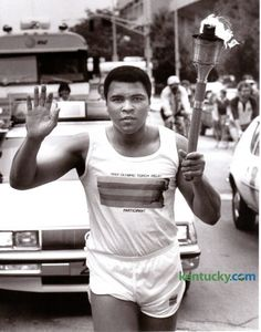 Former heavyweight boxing champion Muhammad Ali took part in the 1984 Olympic Torch Relay through downtown Louisville May 27, 1984. Photo by Ron Garrison | Staff