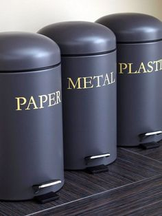 Stylish labeled cans for trash and recycling