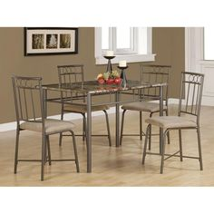 Create a contemporary atmosphere in your dining room with this bronze five-piece dining set. The modern cappuccino-colored chairs provide raised seating for four people, while the sleek marble table is perfect for formal occasions and dinner parties.