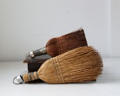 These old-fashioned whisk brooms beat the pants off of ugly modern plastic versions. Love 'em! $24 for two.