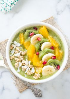Green Coconut Kiwi Banana Smoothie Bowl is taking your green smoothie to the next level!  It's refreshing, healthy, and it's vegan and dairy free.