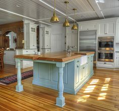 White Country Kitchen With Butcher Block butcher block eating area overlapping quartz counters and