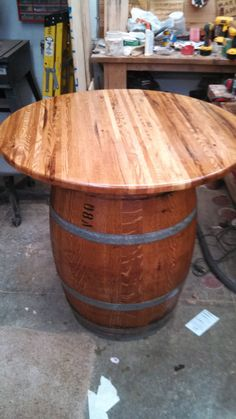 this  is a wine barrel table. Table is made of by normswoodshopCOM