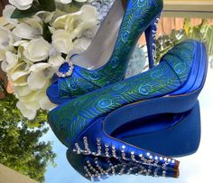 Wedding Shoes Peacock feathers and crystals blue by norakaren, $290.00  I would like them better with out the rhinestones! These cost more than my dress!!!   Lena....OH MY GOODNESS!