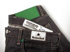 """Après une paire de chaussure signée du célèbre designer Mark McNairy et un sac à dos créé en collaboration avec la marque Killspencer, Heineken présente un jean dans le cadre de #Heineken100. Ce programme qui a débuté il y a quatre ans, vise à faire émerger les créateurs du monde entier qui ont su réinterpréter la philosophie  """"Man of the World"""" initiée par la marque en 2011."""
