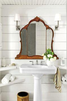 Art Nouveau mirror in modern white bathroom