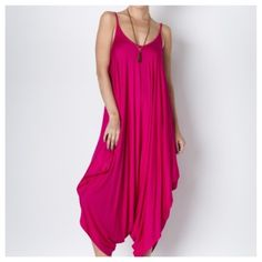 Harem Jumpsuit in Fuchsia Pink NWT. Lightweight and super soft jumpsuit. Made in the USA from a blend of 95% rayon and 5% spandex. Loose and relaxed fit. 1st photo is the actual item. 2nd and 3rd pic for your reference. Listing is for a fuchsia jumpsuit. PRICE FIRM UNLESS BUNDLED/NO TRADES Pants Jumpsuits & Rompers