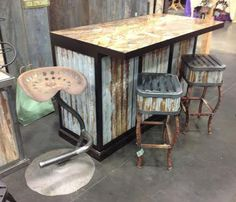 How about this old bar.  We used a slap of granite and old recycled tin. stools to match with old t-posts.  And how about the old tractor seat stool?