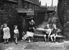 Children play in the alleys behind their terraced houses in Salford, 1962 (Shirley Baker)