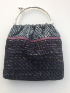 Beautiful Irish wool tweed handbag with a grosgrain ribbon accent, lined in satin and finished inside with the same ribbon. The handle is silver colour and has a snap closure. The bag itself measures approx and the total height including the handle is Grosgrain Ribbon, Tweed, Irish, Handle, Satin, Trending Outfits, Tote Bag, Wool, Unique Jewelry