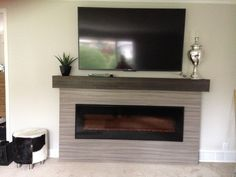 Linear Fireplace With Tv Above Extraordinary After Surround Box Mantle Home Interior 26