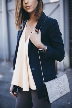 blush loose fitting blouse, navy blazer and grey skinny's