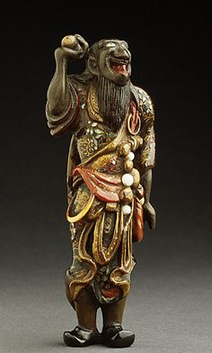 Netsuke  ~  Daoist Immortal with Sacred Jewel  ~  18th century   Wood with later lacquer, inlays
