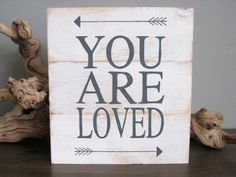 White and gray distressed rustic YOU ARE LOVED by OceansideStudios, $35.00.  white nursery sign, sign with arrows, boy nursery, rustic sign, planked sign, nursery decor, baby sign.