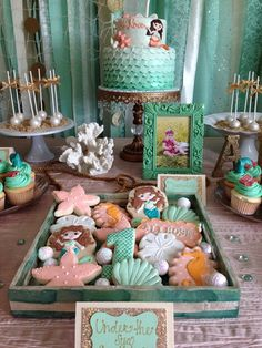 Amazing cookies and cake at a  Mermaid Birthday Party!  See more party ideas at CatchMyParty.com!
