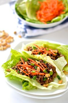 Healthy Asian Lettuce Wraps With Lean Ground Beef, Olive Oil, Onions, Garlic, Ginger, Water Chestnuts, Hoisin Sauce, Soy Sauce, Bibb Lettuce, Shredded Carrots, Peanuts, Toasted Sesame Seeds, Green Onions