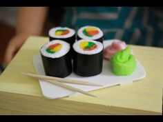 How to make doll sushi - myfroggystuff - youtube video. (She even shows you how to make what she uses to plate the food! kj)