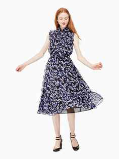 a midi-length silk number decorated with hydrangeas, the patio dress is so named because it's perfect for garden parties. but, thanks to the dark-hued fabric and bow-tied neck, it'll also work for wor
