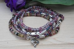 Sterling silver wrap bracelets made with Amethyst Tourmaline