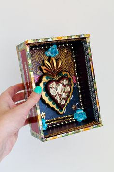 Mexican art shrine with wooden sacred heart shadow box // multicolor // Shrine diorama with wood heart with milagros // Mexican folk art. $42.00, via Etsy.