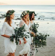 Love a subtler version of their head pieces and bouquets - white bridesmaids with flower crowns