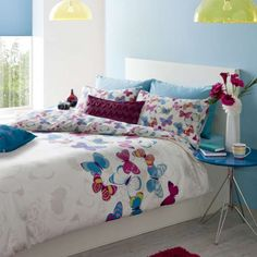 Butterfly Fusion Duvet Cover - Natural bedding for girls with hot pink & teal coloured butterflies. Perfect for any girls butterfly themed bedroom. It comes in single or double size duvet cover.