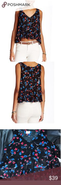 Free People  Crop Top Adorable Free People crinkled, destructive crop top.  Has a gorgeous floral print with bright reds and blues.  Does have a destructive look with threads hanging loose throughout the top (this was how the shirt was made new).   - Sleeveless - Cropped - Tiered construction - Allover print Fiber Content 100% rayon Free People Tops Crop Tops