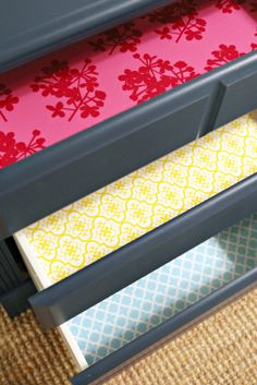 spray adhesive + wrapping paper to line drawers...