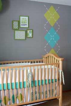argyle for an accent...but I would paint it horizontally over the space above the crib and write their name somewhere along the dotted white line