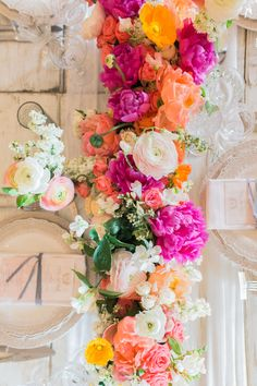 Bright and colorful wedding table decor: http://www.stylemepretty.com/2016/12/27/charming-garden-floral-wedding/ Photography: Annie Mcelwain - http://www.anniemcelwain.com/book/i