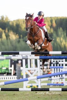 Olivia Dalton and her 13.3hh pony Just Nuts fly over a 1.55m oxer to win the Cheleken Equestrian Pony Six Bar. And with one stirrup! Photo credits to iSpyHorses and Lesley Warwick