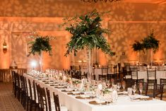 Indoor, Ballroom Wedding Reception Decor with Tall, Greenery Centerpieces in Glass Vases, Bamboo Chiavari Chairs, and Candlelight | Tampa Wedding Venue Tampa Marriott Waterside