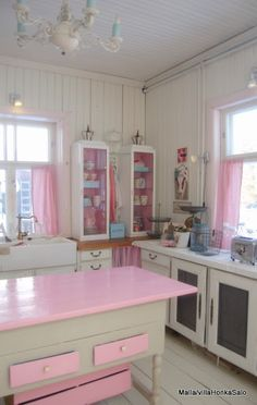 I don't love all the pink... but the kitchen is very much my taste.  Screened doors, open shelves, wooden cabinets, big, old fashioned sink.