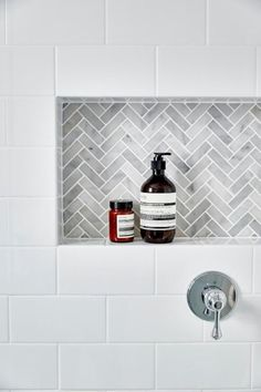 White subway tiles frame a gray marble herringbone tiled shower niche.Another niche idea. White subway tiles frame a gray marble herringbone tiled shower niche. Tiny House Bathroom, Bathroom Renos, Laundry In Bathroom, Bathroom Interior, Bathroom Remodeling, Remodeling Ideas, Bathroom Marble, Subway Tile Bathrooms, Subway Tile Showers