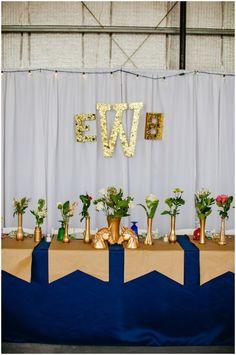 gold, glitter, unicorn, kate spade wedding!!! upcycled, spraypainted jars as decor <3