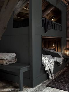 Attic bunk room with exposed ceiling over charcoal gray built-in bunks layered with gray and white bed linens with a built-in bench at the foot of the bunks over unfinished hardwood floor layered with a black rag rug. Houses Architecture, Interior Architecture, Interior Design, Interior Decorating, Decorating Ideas, Decor Ideas, Home Bedroom, Bedroom Decor, Master Bedroom