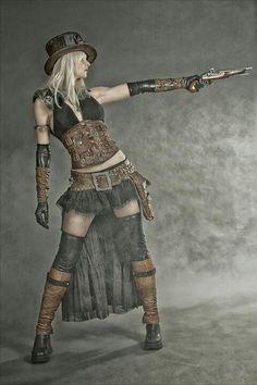 Pela arma e pela pose teria tudo para ser pirata mas com essas roupas vai pra pasta steampunk
