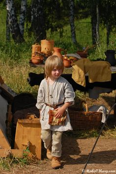 "Little Viking/Rus reenactor.The best way for kids to learn what life for our ancestors was like, and hopefully develop a critical attitude to our suicidal, ""modern lifestyle""! http://russiamagazine.livejournal.com/17267.html"