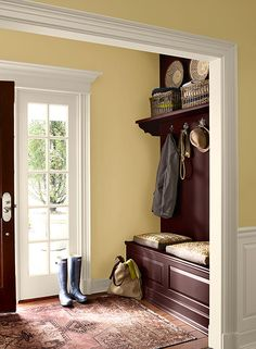 Benjamin Moore: straw walls and sugar cookie trim.  I loved yellow in my entry.  It photographed well for prom photos too.