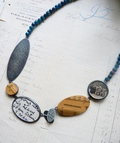 Necklace with line of finds, apatite beads, oxidised silver, vintage ruler, postcards | by Clare Hillerby