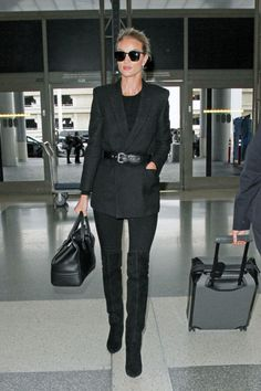 Rosie Huntington-Whiteley in a belted black blazer and skinny pants at the airport
