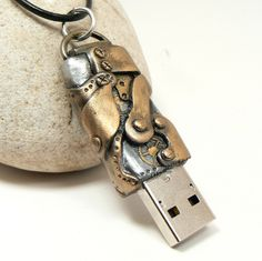Beneath the Surface (Summer Reading Program 2013): steampunk flash drive, usb by Desert Rubble, via Flickr